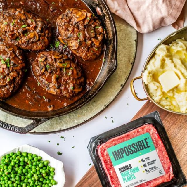 """Impossible™ Salisbury-Style """"Steak"""" by Meiko Temple, made with mushrooms and Impossible™ Burger"""