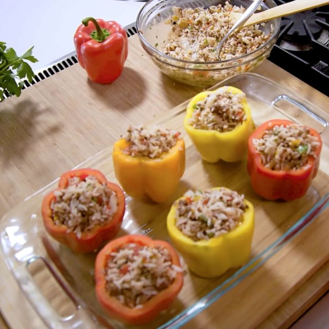 Multi colored Impossible Stuffed Bell Peppers made with Impossible Burger by Chef Mimi in glass baking dish