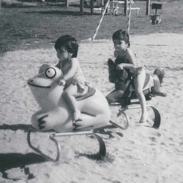 Edith Villanueva advocating for full inclusion and support for our LGBTQ+ Youth is pivotal thumbnail - picture of two young girls on a playground black and white