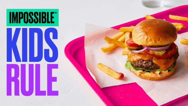 """Impossible Burger on pink lunch tray with """"Kids Rule"""" title."""