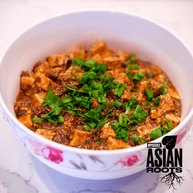 Impossible™ Mapo Tofu Recipe using meat made from plants, tofu, garlic, ginger, and Sichuan pepper.