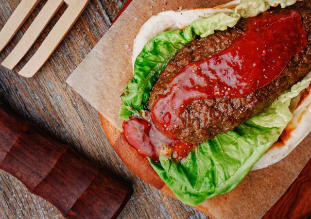 Impossible Satay Prata over lettuce served on wooden block