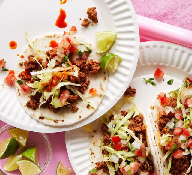Impossible Street Tacos Recipe on paper plates by Impossible Burger.