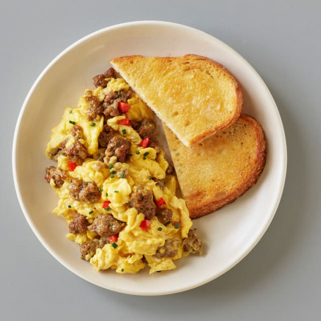 Impossible™ Sausage Scramble made with Impossible™ Savory Sausage Made From Plants and red bell pepper cooked with eggs