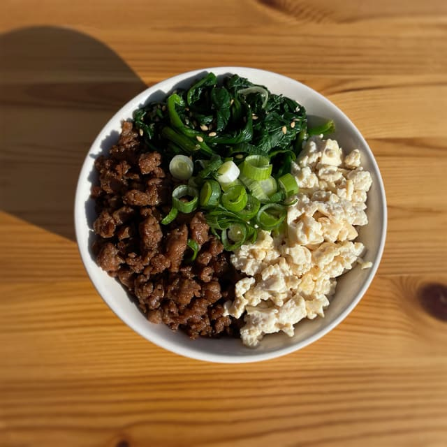 Create this Impossible™ Sanshoku Don Recipe using meat made from plants, rice, savory tofu and spinach for a Japanese favorite.