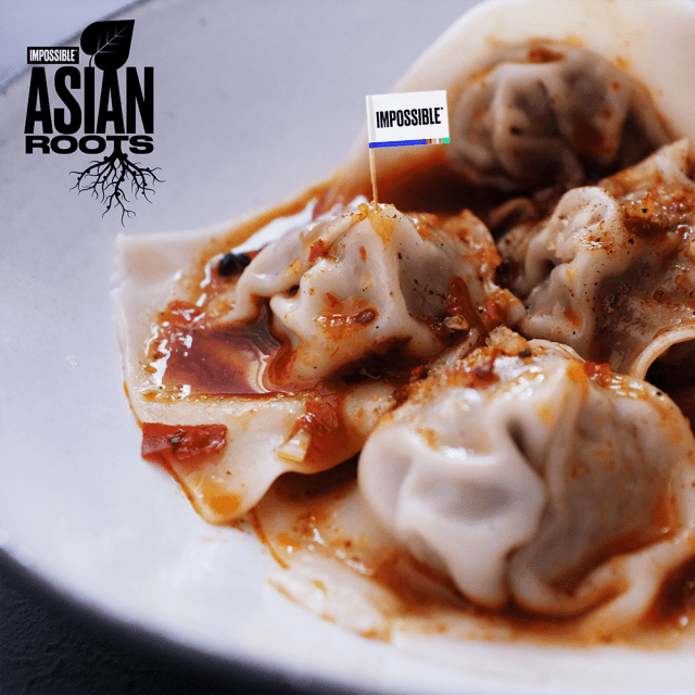Impossible™ Red Oil Wontons Recipe using meat made from plants, homemade red oil sauce, and freshly ground Sichuan peppers.