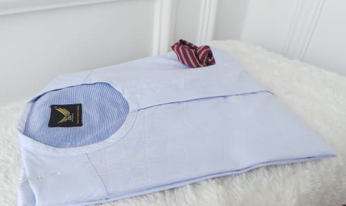 Light blue striped male traditional attire