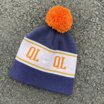 THE QUIET LIFE BRIGHT POM BEANIE - ORANGE NAVY