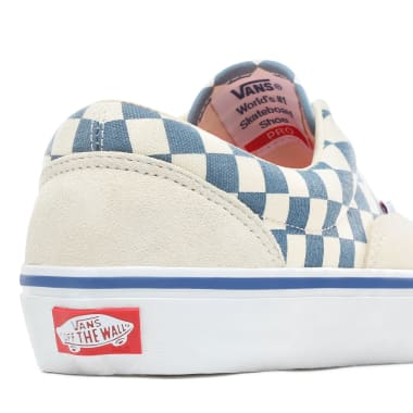 The Vans Checker Era Pro is a low top lace-up shoe. It is padded and lined for extra comfort, has waffle outsoles for a firmer grip, and UltraCush™ HD sockliners to keep the foot close to the board while providing the highest level of impact cushioning.