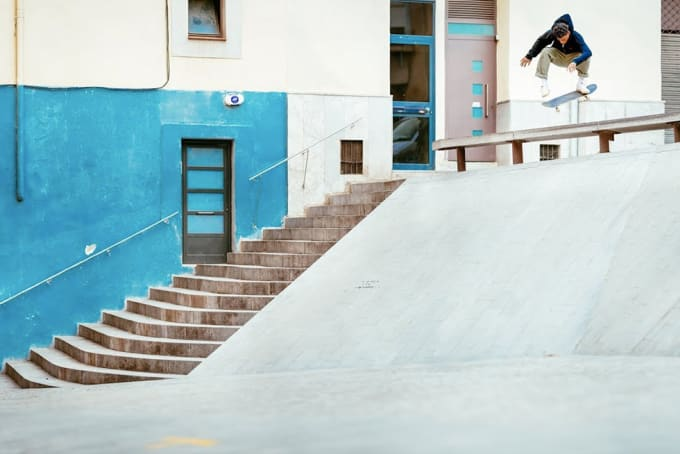 2. Robert Neal in Primitive Skateboarding's Encore video. Kickflip over bench into bank. Barcelona.