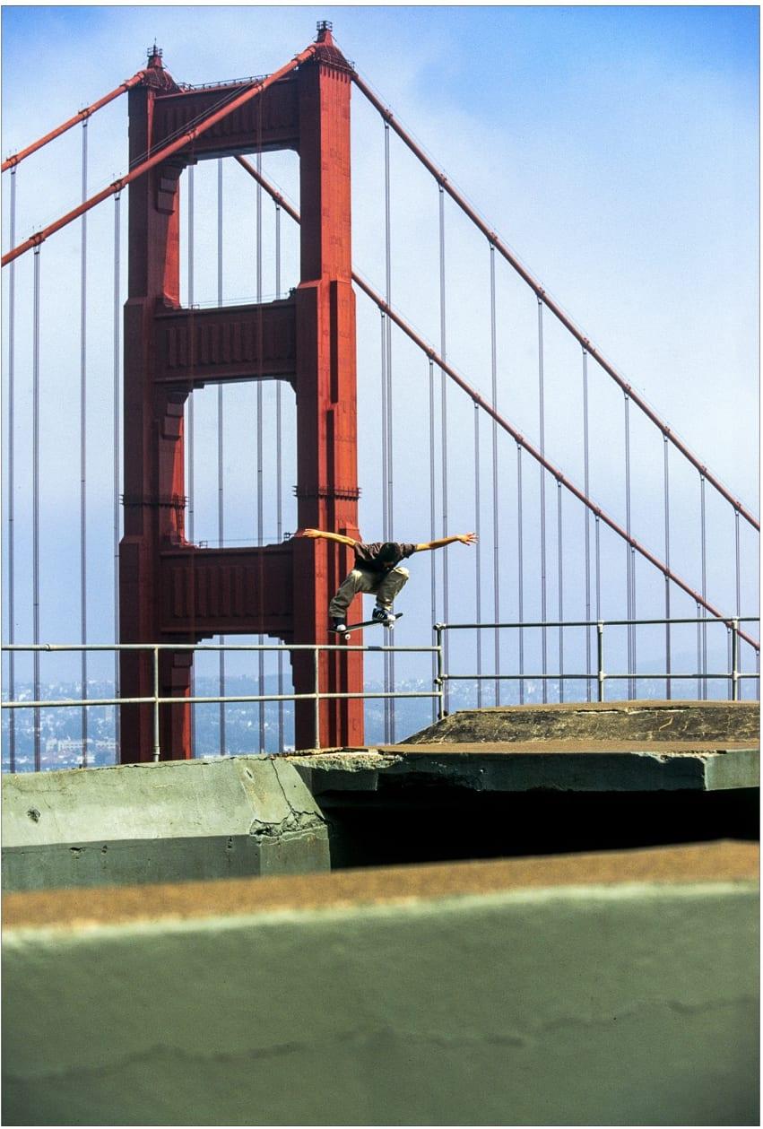 Josh Kalis, 1995 in San Francisco. Backside 180. Shot by skateboard photographer Skin Phillips. As seen on the cover of Transworld Skateboard Magazine.