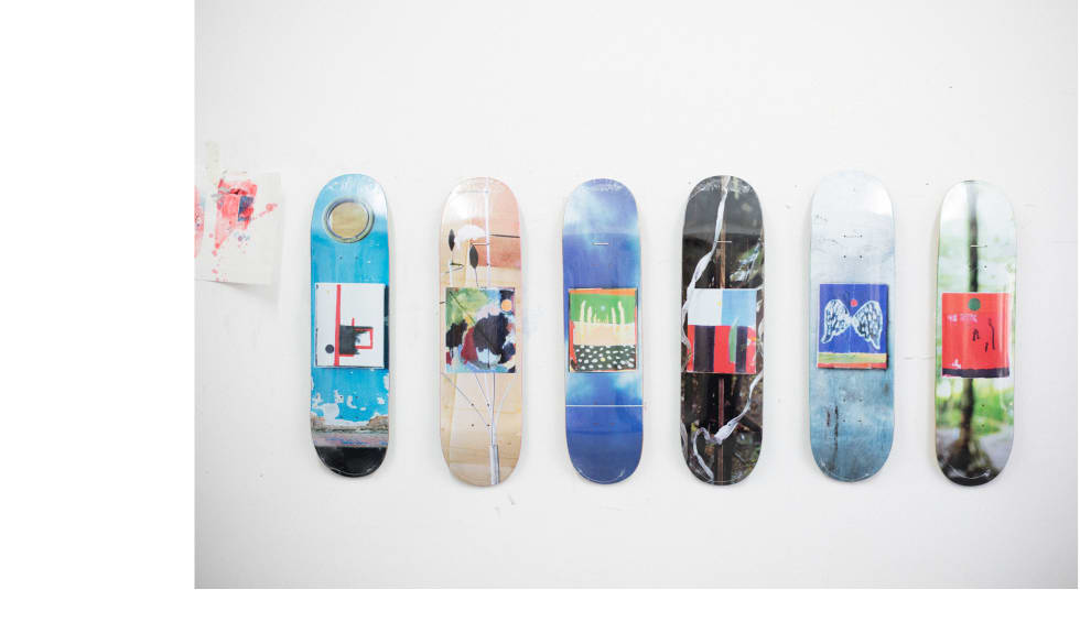 The full range of Isle Skateboard decks on display in Nick Jensen's art studio.