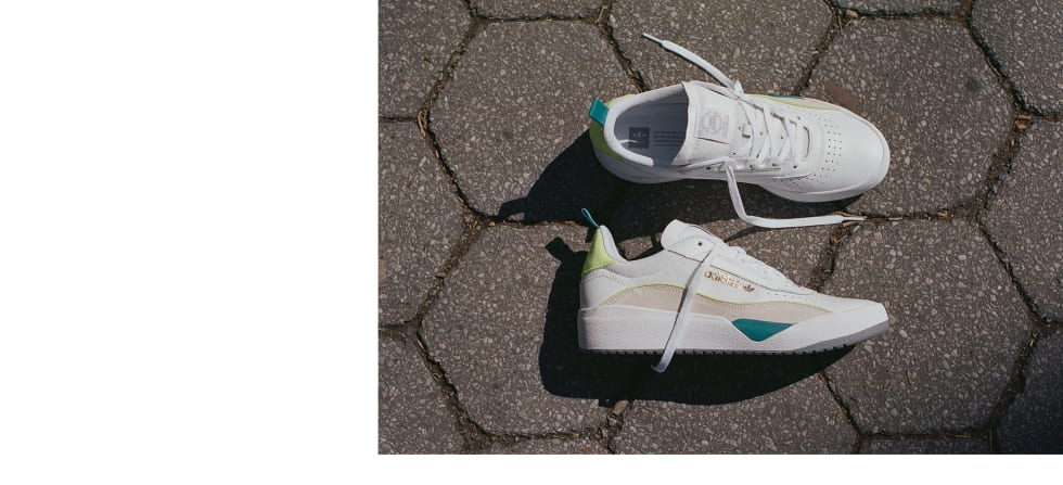 1. adidas Skateboarding Liberty Cup in cloud white, chalk white, hi-res yellow. adidas EE6104