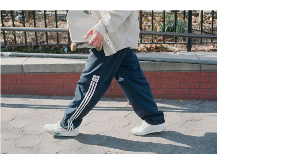 2. Heitor da Silva wearing the adidas Skateboarding Liberty Cup in cloud white, chalk white, hi-res yellow in New York City. adidas EE6104