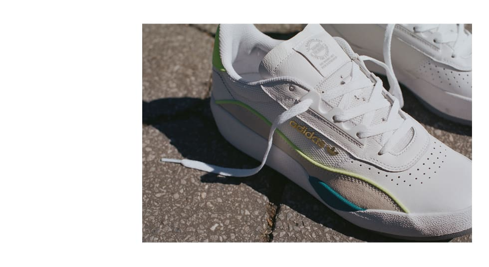 4. adidas Skateboarding Liberty Cup in cloud white, chalk white, hi-res yellow. adidas EE6104