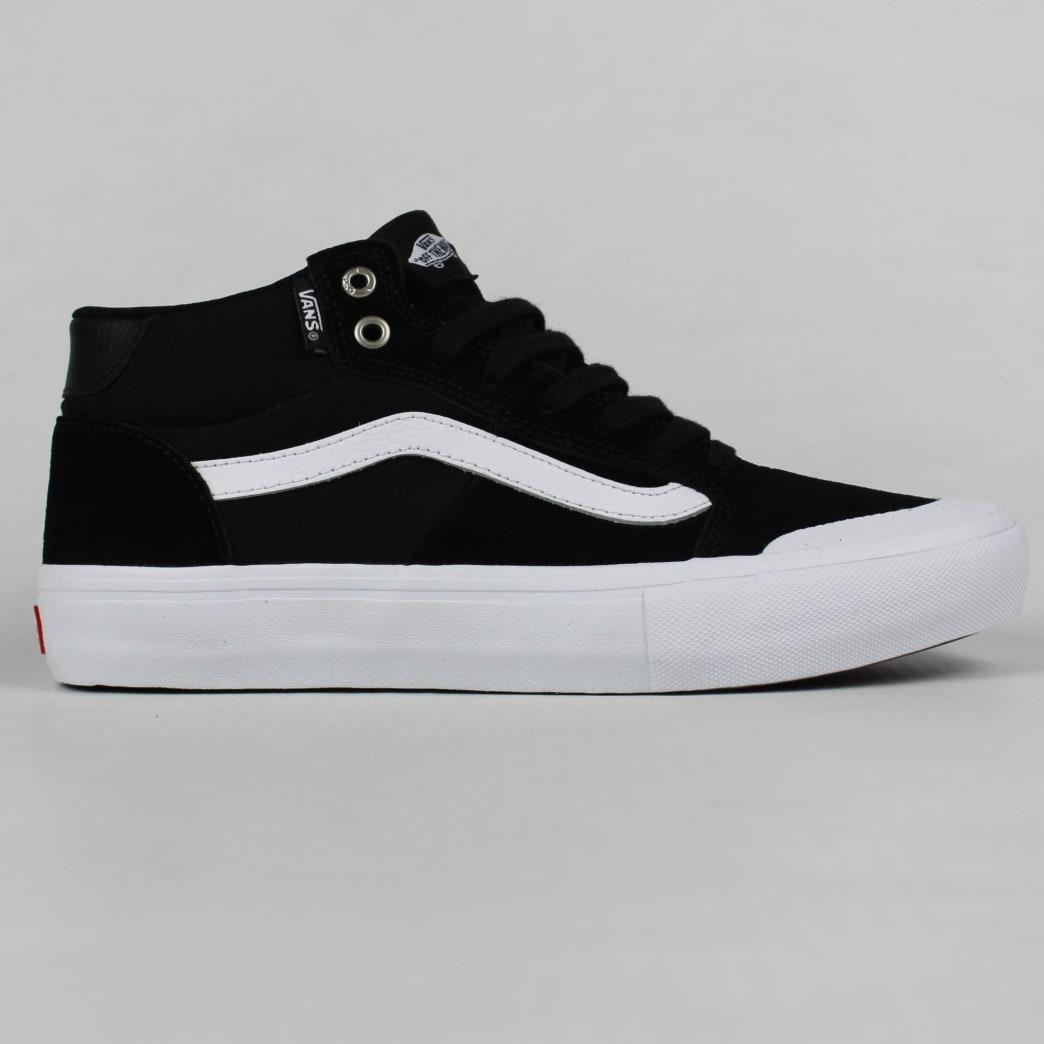 fa65093835ae43 Shop Vans 112 Mid Pro Shoes Black White