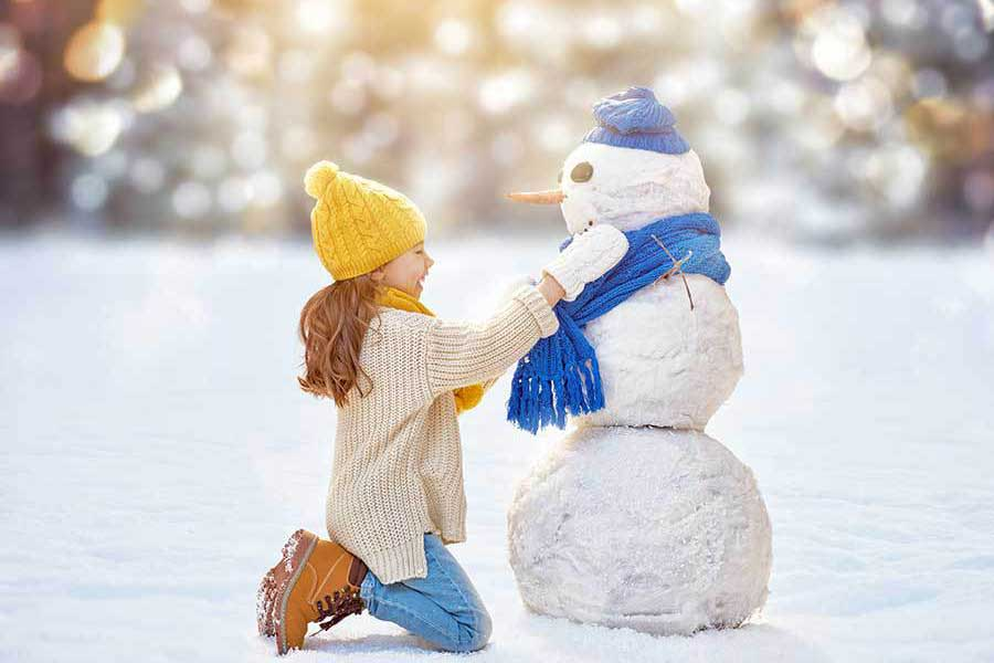 building a snowman after-school holiday activities