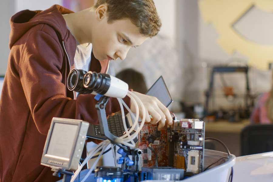 A boy programming a robot