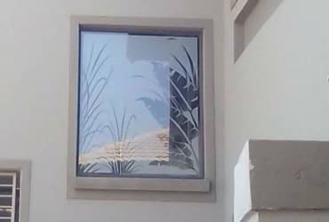 Decorative window frosting and tinting services