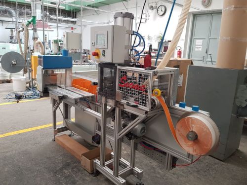 Machine for cutting and assembling of ''seal strip''