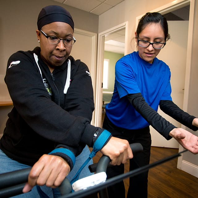 Spine and Joint Associates employee helping patient with physical therapy