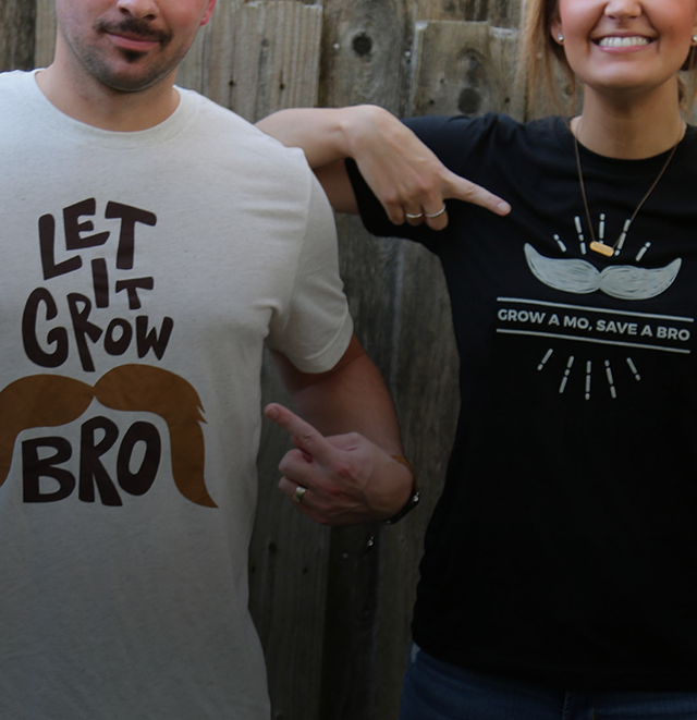 Leverage team members showing off Movember T-shirts.