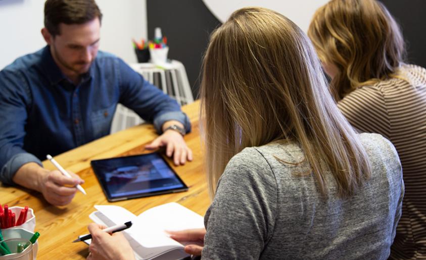 Brainstorming session to determine marketing tactics.