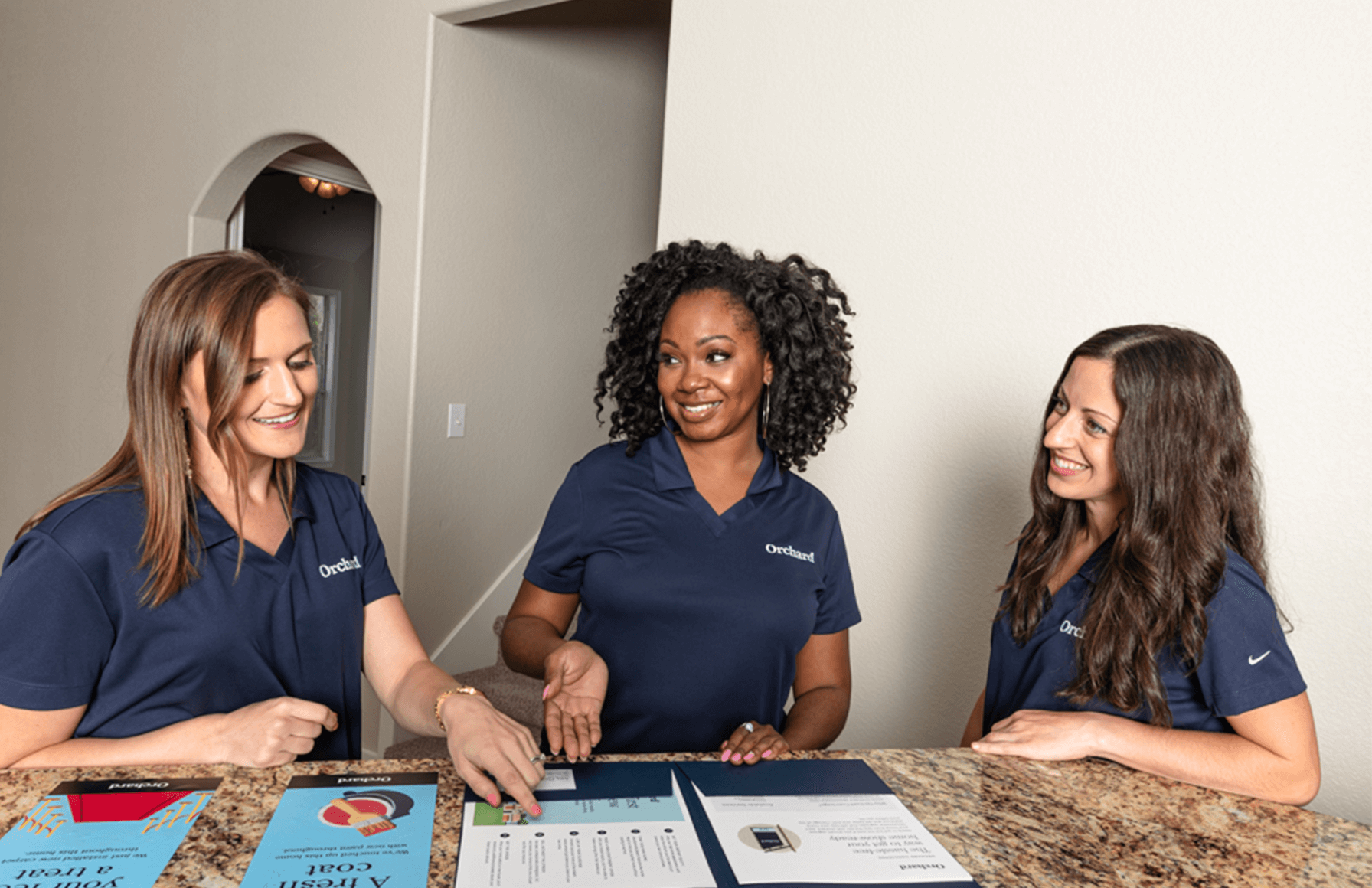 Three Orchard Home Advisors during an open house in Austin