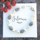 Blue Kyanite Bracelet - Such an elegant single stranded bracelet handmade in Britain from the beautiful pale blue gemstone Kyanite, luxurious ivory freshwater pearls and sparkling Swarovski crystals in clear and aquamarine.