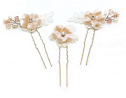 Briony Pins - Exquisite floral bridal pins featuring silk velvet flowers in soft blush with a pretty diamante centre. Two of the set of three pins have pieces of lace and a pretty spray of dainty freshwater pearls and blush Swarovski crystals while the third includes an ivory silk lace flower.