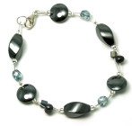 Tundra Bracelet - Simply stunning designer bracelet that flashes black/blue. Available in a range of sizes.