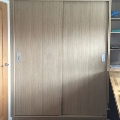 Scribe-in sliding door cabinet in Aragon Oak