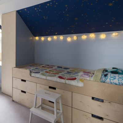 Child bed with birch ply cabinetry underneath