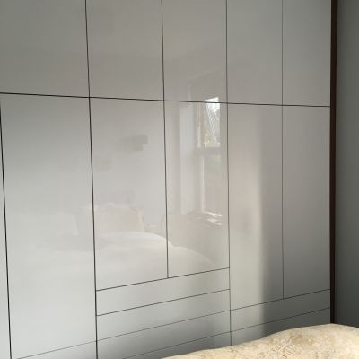 High gloss white wardrobe with walnut MFC carcass