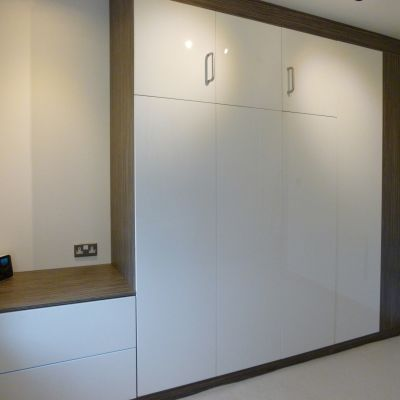 side board with drawers and foldaway bed in wardrobe