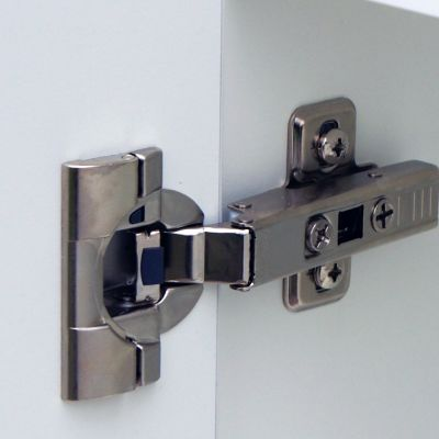 This hinge has integrated Blumotion slow closing action that can be switched on and off using the small grey switch. The hinge boss is the INSERTA variant which we use whenever possible as the hinge can be fitted without screws