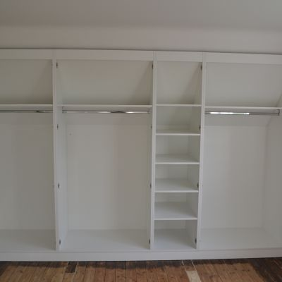 Angled cabinetry in eaves