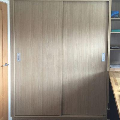 Scribe-in sliding door cabinet in Aragon Oak