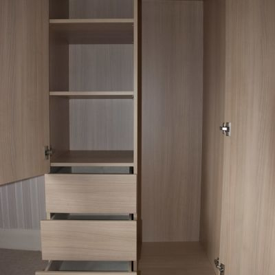 guest wardrobe with drawers open