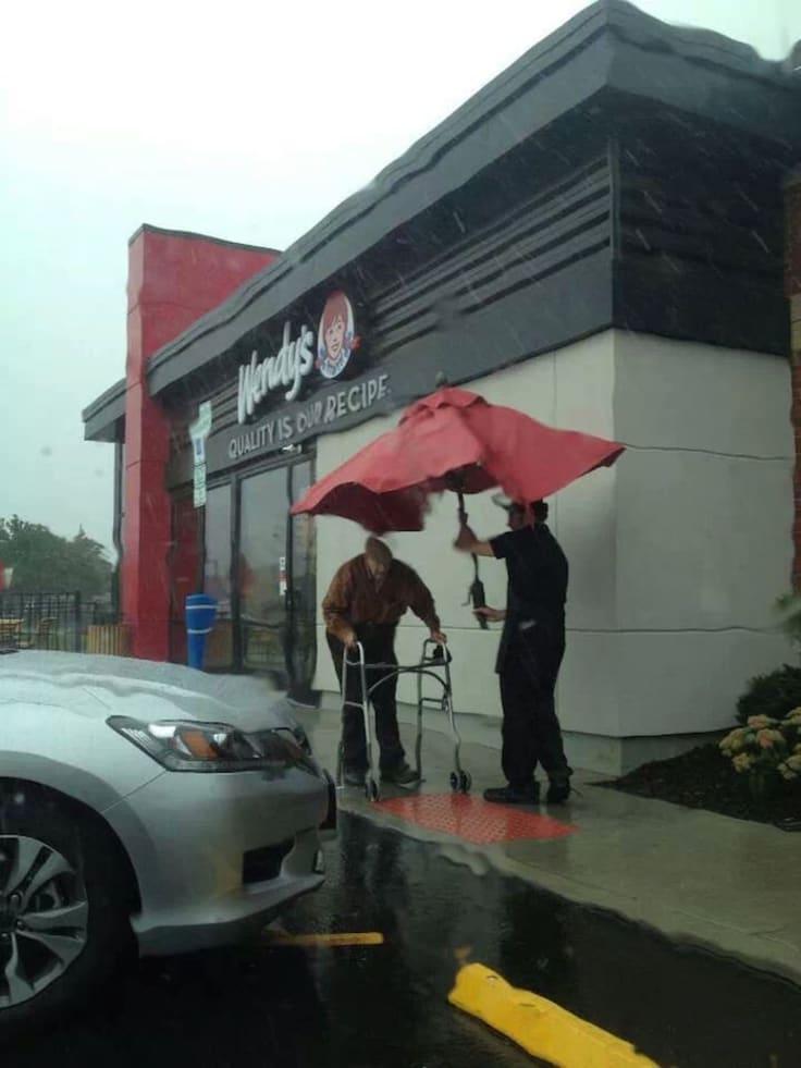 Customer service staff help old man