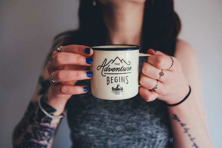 adventure begins cup hold tattooed girl woman