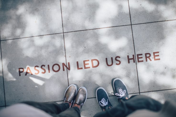 passion led us here sign pavement
