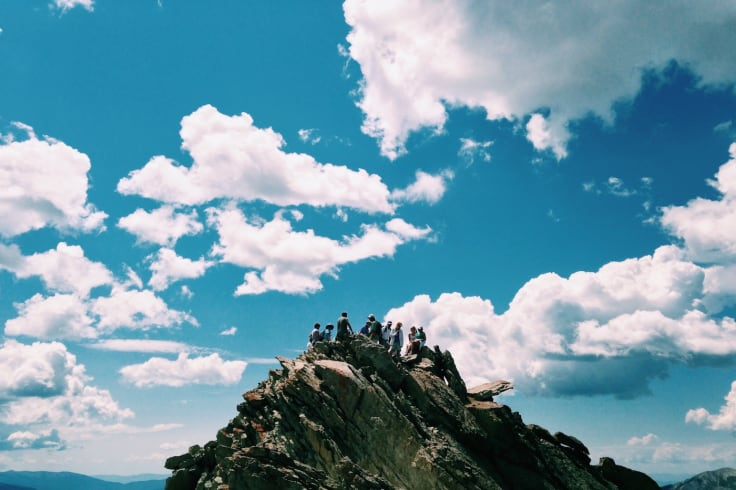 people mountain top corporate team building