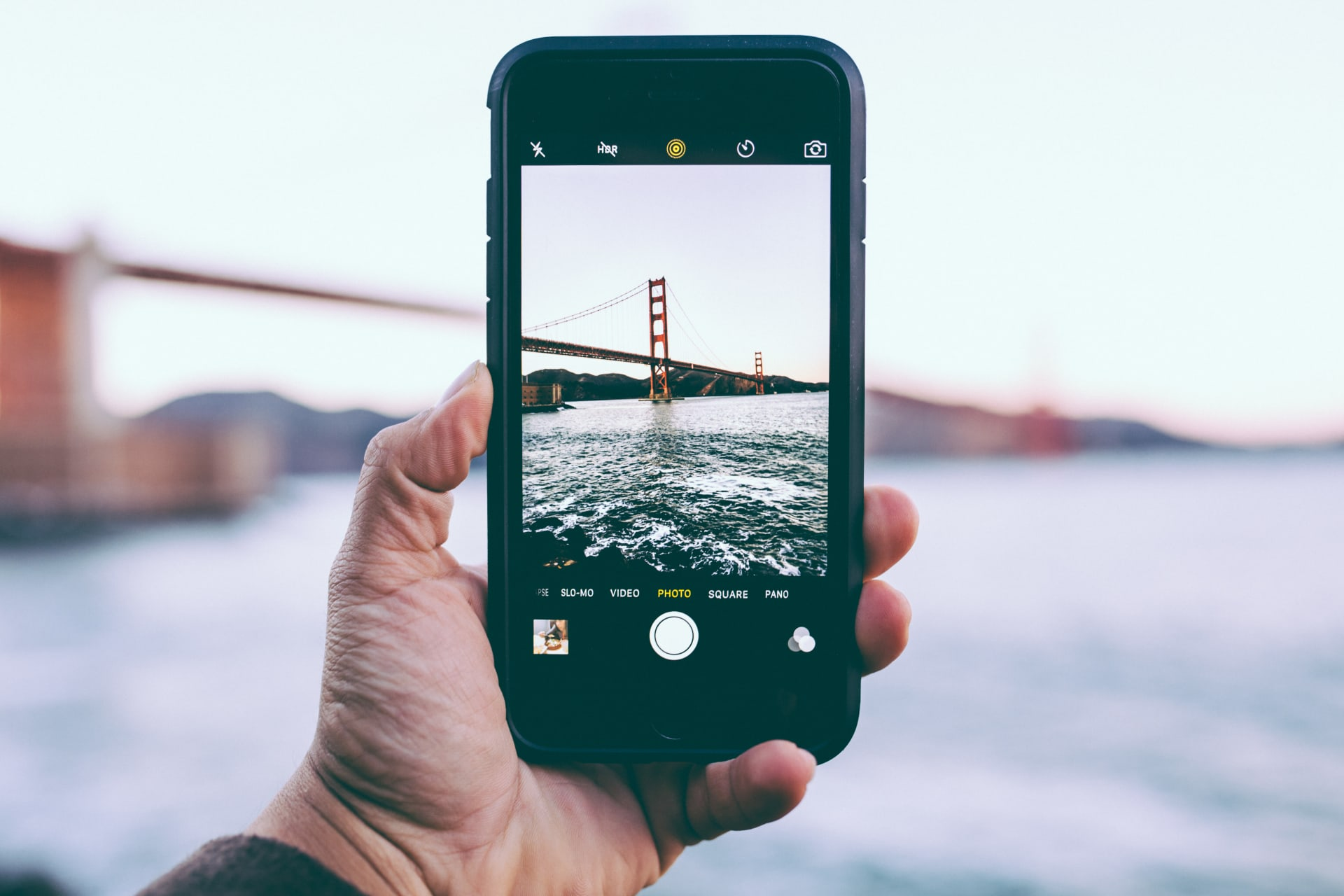 person taking photo of Golden Gate Bridge, California