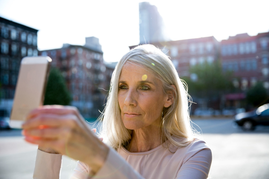 Mature woman taking a selfie