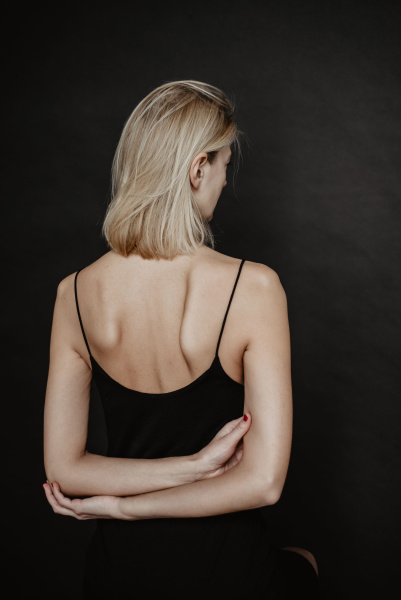 Woman wearing tank top with her back to the camera