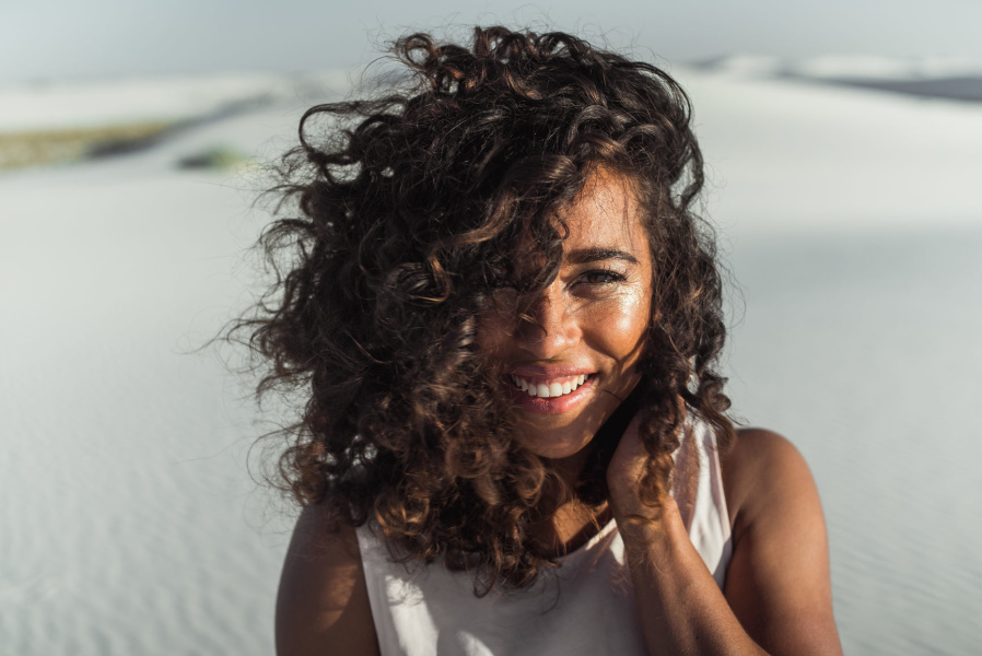 Woman touching her curly hair
