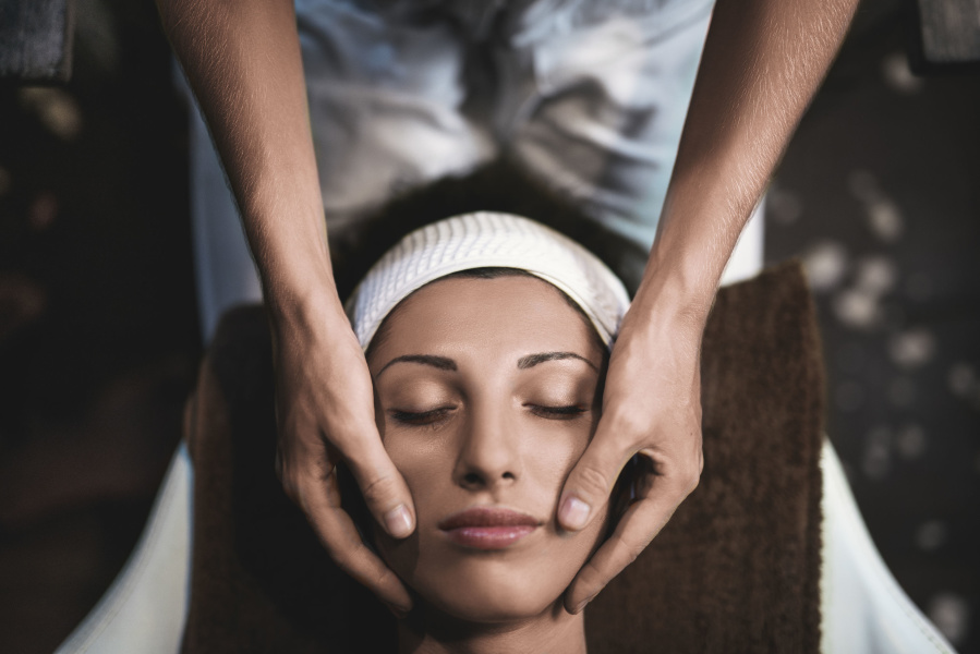 Woman with eyes closed getting a beauty treatment