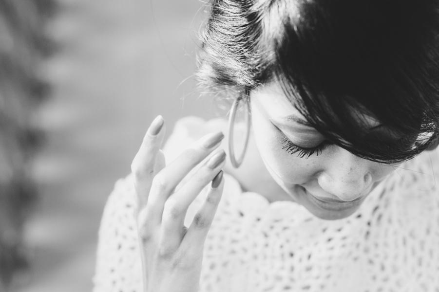 Woman touching earrings