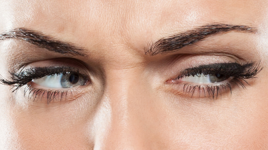 Woman furrowing her brow